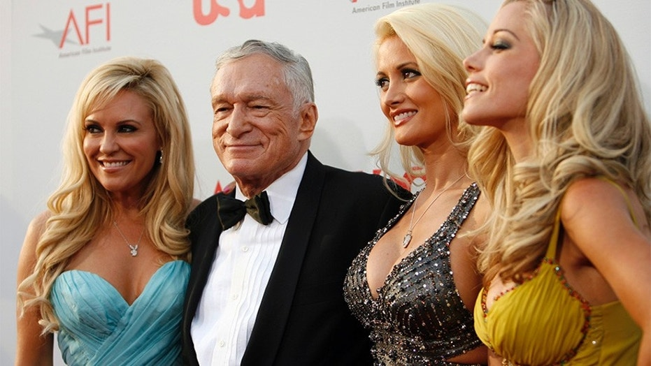 Hugh Hefner (2nd L) poses with Bridget Marquardt (L), Holly Madison and Kendra Wilkinson (R).