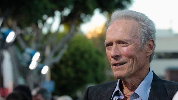 "Cast member Clint Eastwood is interviewed at the premiere of ""Trouble with the Curve"" at the Village Theatre in Los Angeles, California September 19, 2012. The movie opens in the U.S. on September 21.   REUTERS/Mario Anzuoni (UNITED STATES - Tags: ENTERTAINMENT HEADSHOT)"
