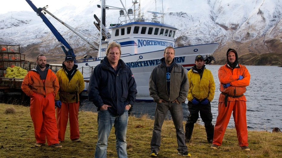 Captain Sig Hansen, in dark blue jacket, poses with the crew of the 'Northwestern'