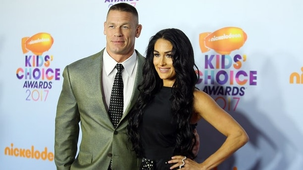2017 Kids' Choice Awards - Arrivals - Los Angeles, California, U.S., 11/3/2017 - Show host John Cena and Nikki Bella. REUTERS/Mike Blake - RTX30MJH