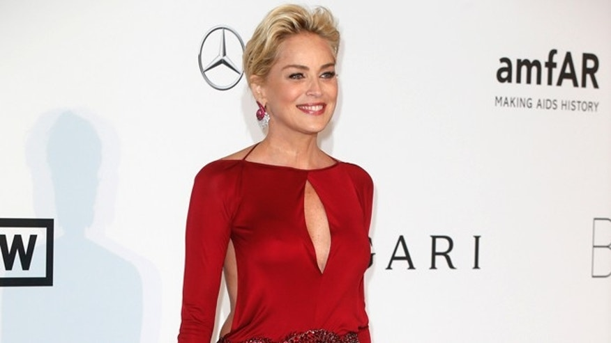 Actress Sharon Stone arrives for amfAR's Cinema Against AIDS 2014 event in Antibes during the 67th Cannes Film Festival May 22, 2014. REUTERS/Benoit Tessier (FRANCE - Tags: ENTERTAINMENT) - RTR3QGGB