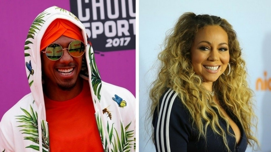 "Television personality Nick Cannon discussed his split from pop singer Mariah Carey and said he is not looking for a relationship at the moment because the divorce left him ""broken."""