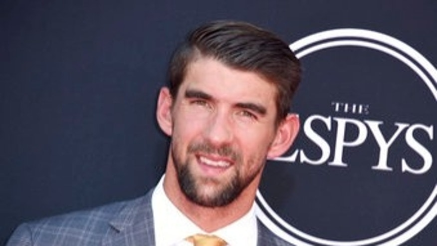 Michael Phelps arrives at the ESPYS at the Microsoft Theater on Wednesday, July 12, 2017, in Los Angeles. (Photo by Jordan Strauss/Invision/AP)