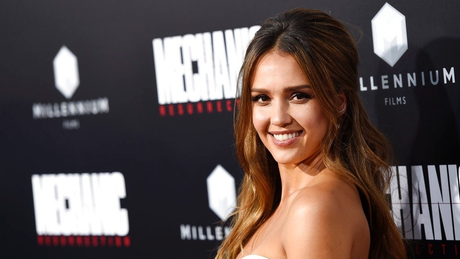 "Jessica Alba, a cast member in ""Mechanic: Resurrection,"" poses at the premiere of the film at the Arclight Hollywood in Los Angeles. (Associated Press)"