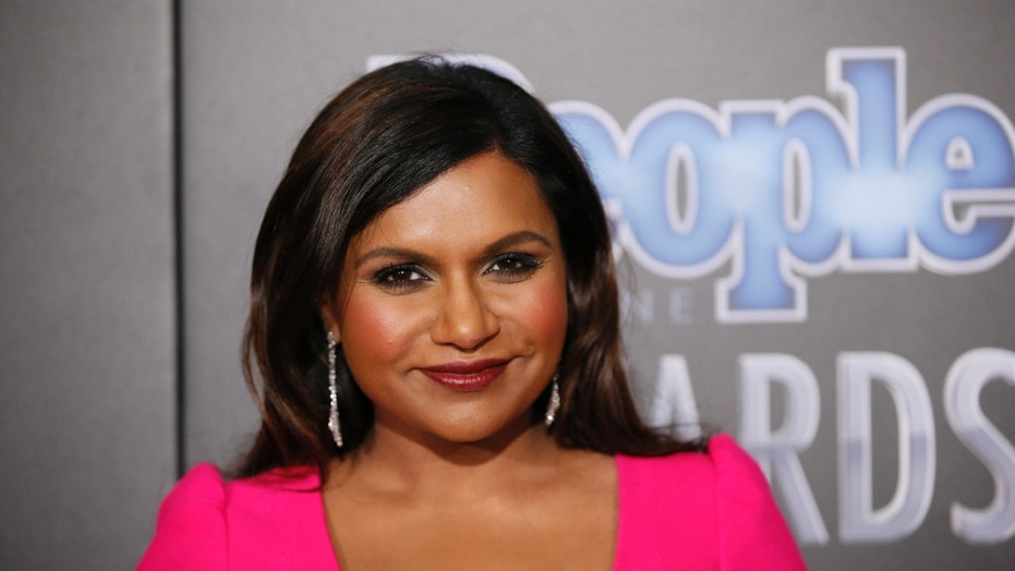 December 18, 2014. Actress Mindy Kaling poses backstage at the People Magazine Awards in Beverly Hills, California.