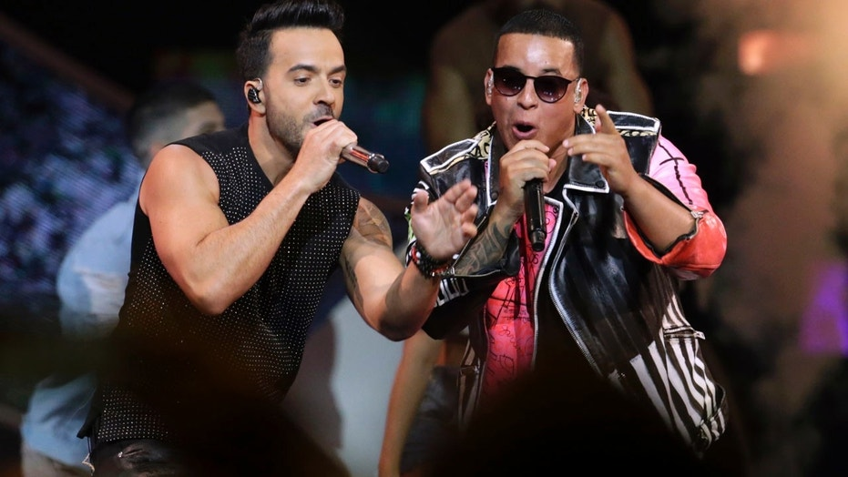 FILE 2017:  Luis Fonsi, left and Daddy Yankee perform during the Latin Billboard Awards in Coral Gables, Fla.