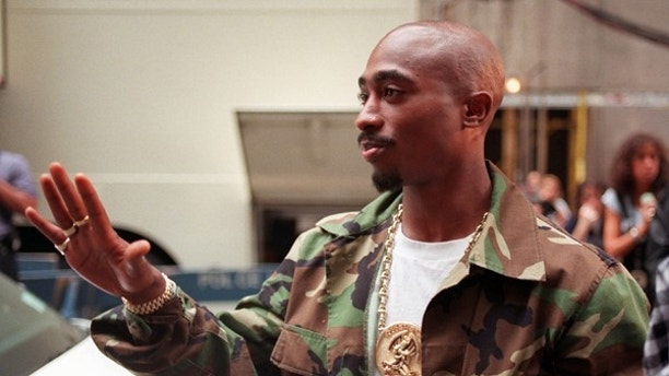 FILE- In this Sept. 4, 1996 file photo, Rapper Tupac Shakur arrives at New York's Radio City Music Hall for the 13th Annual MTV Video Music Awards. A New York judge has stopped on Tuesday, July 18, 2017, an impending auction of pop star Madonna's personal items, including a love letter from Shakur, her former boyfriend. (AP Photo/Todd Plitt, File)