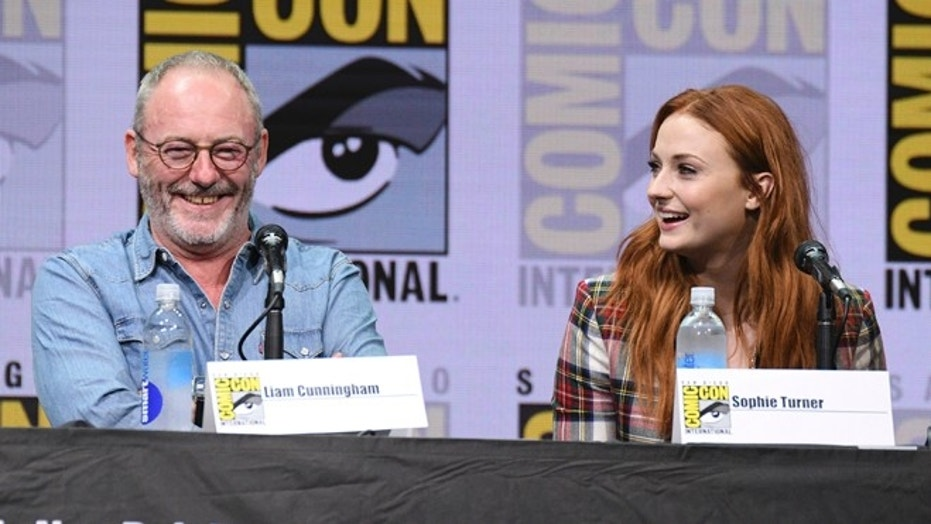 "Liam Cunningham and Sophie Turner attend the ""Game of Thrones"" panel at Comic-Con."
