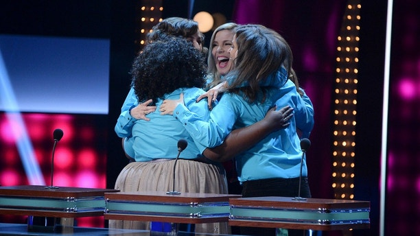 "CELEBRITY FAMILY FEUD - ""Funny Gals vs Funny Guys and Louie Anderson vs Christina Milian"" - The celebrity teams competing to win cash for their charities feature comedians/actors from popular shows like ""Grace & Frankie,"" ""Fresh Off the Boat"" and ""Saturday Night Live."" In a separate game, family members from the multi-talented actress/singer/businesswoman Christina Milian will take on iconic comedian Louie Anderson and his family. This episode of ""Celebrity Family Feud"" airs SUNDAY, JULY 23 (8:00-9:00 p.m. EDT), on The ABC Television Network. (ABC/Eric McCandless)