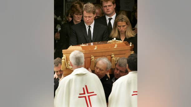 Britain's Earl Spencer (top 2nd L), with his sister, Lady Sarah McCorquodale (L) and wife, Caroline (R) follow the coffin of his mother Frances Shand Kydd during her funeral at St Columba's Cathedral in Oban in Scotland, June 10, 2004. Shand Kydd, mother of the late Princess Diana, was laid to rest on Thursday on the remote Scottish coast where she spent her last years shunning the royal family and where she died on June 3 aged 68. REUTERS/Jeff J Mitchell  JJM/ASA - RTR44A0