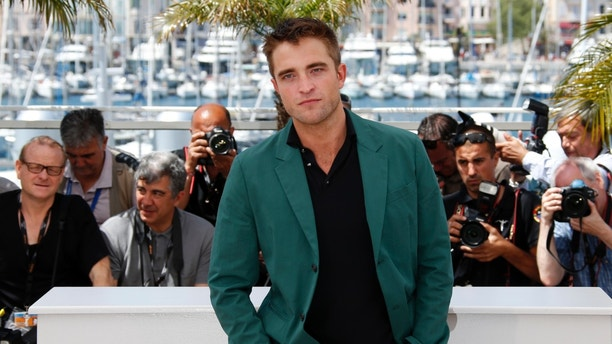 "Cast member Robert Pattinson poses during a photocall for the film ""The Rover"" out of competition at the 67th Cannes Film Festival in Cannes May 18, 2014.      REUTERS/Benoit Tessier (FRANCE  - Tags: ENTERTAINMENT)   - RTR3PO4N"