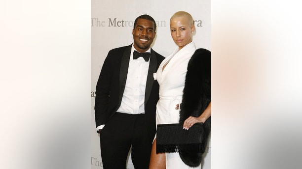Musician Kanye West arrives with Amber Rose to attend the 125th Anniversary gala of the Metropolitan Opera in New York March 15, 2009. REUTERS/Lucas Jackson (UNITED STATES ENTERTAINMENT) - RTXCTWT