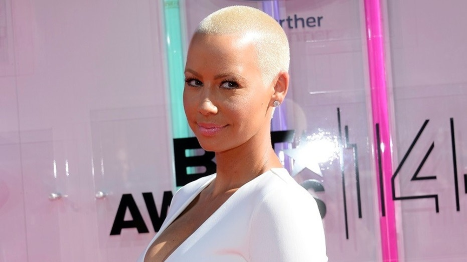 Model Amber Rose opened up about her breakup with rapper Kanye West in 2010 in an interview Tuesday.