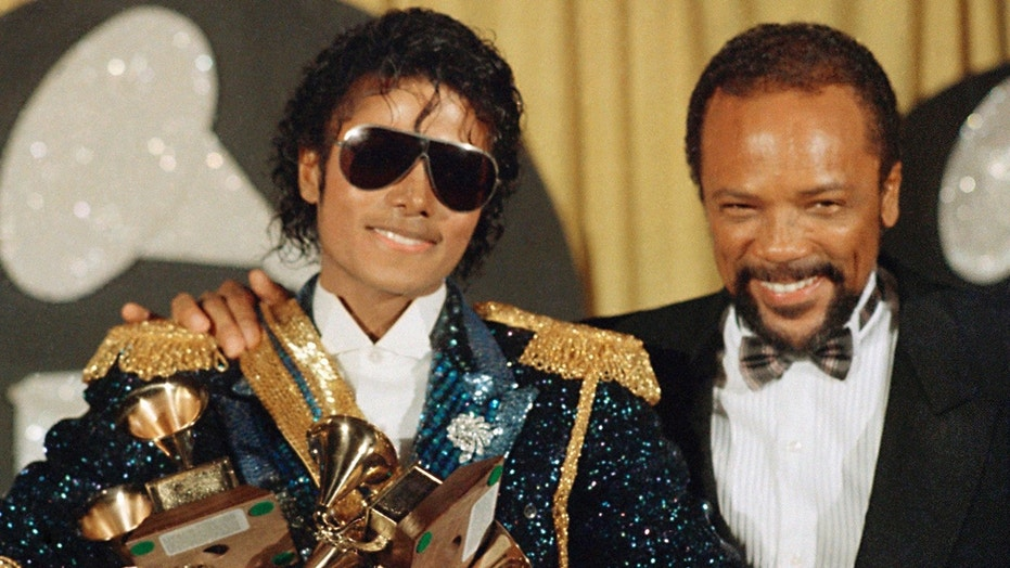 Michael Jackson (left) and Quincy Jones (right) posing together in 1984.