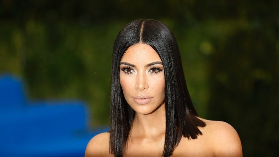 Reality television star Kim Kardashian's cell phone case company has been sued $100 million Monday for patent infringement.