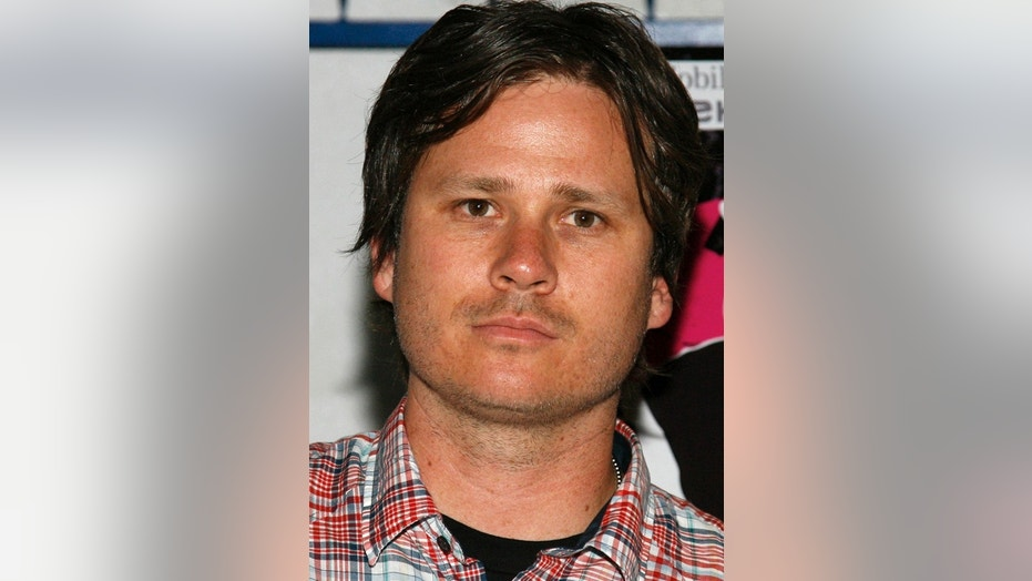 Blink-182 guitarist and vocalist Tom Delonge poses at a party to launch the band's summer tour at El Compadre Restaurant in Los Angeles, California, May 18, 2009. REUTERS/Danny Moloshok (UNITED STATES ENTERTAINMENT HEADSHOT) - RTXJ72E
