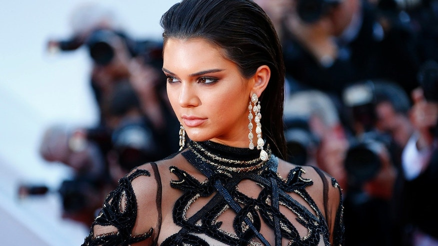 "Model Kendall Jenner poses on the red carpet as she arrives for the screening of the film ""Mal de pierres"" (From the Land of the Moon) in competition at the 69th Cannes Film Festival in Cannes, France, May 15, 2016. REUTERS/Yves Herman - RTSEEZA"