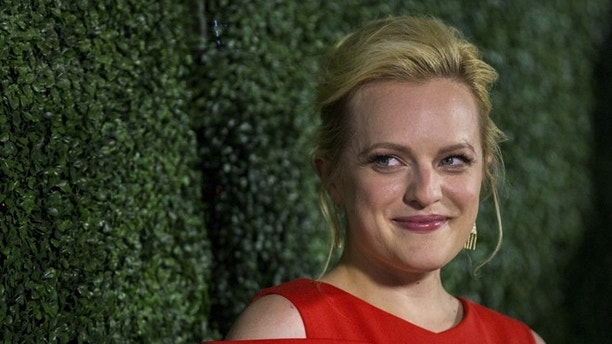 Cast member Elisabeth Moss poses at an industry screening of