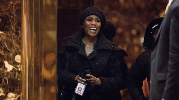 In this Jan. 2, 2017, photo, Omarosa Manigault arrives at Trump Tower, in New York. A memorable contestant in the first season of �The Apprentice,� Manigault is expected to join President-elect Donald Trump�s White House staff, according to two people familiar with the decision. Her job is expected to focus on public engagement. (AP Photo/Andrew Harnik)