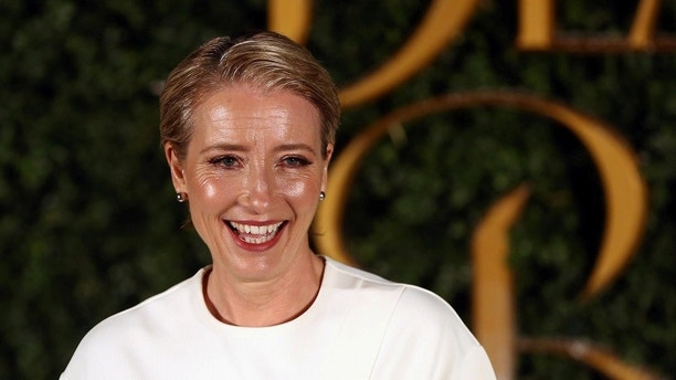 Actor Emma Thompson poses for photographers at media event for the film Beauty and the Beast in London, Britain February 23, 2017. REUTERS/Neil Hall - RTS101J3
