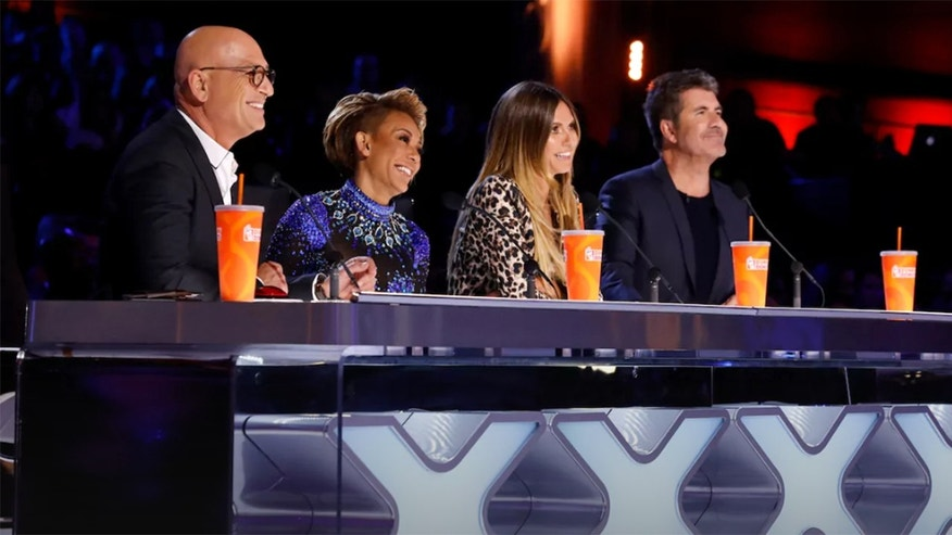 Singer Mel B throws water at Simon Cowell