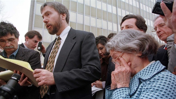 Wanda Kaczynski (R), mother of convicted Unabomber Ted Kaczynski, wipes tears from her eyes as Ted Kaczynski's brother David talks to the press outside the U.S. Courthouse in the Fred E. Moss Federal Building January 22. Ted Kaczynski pleaded guilty in court today to all charges filed against him.