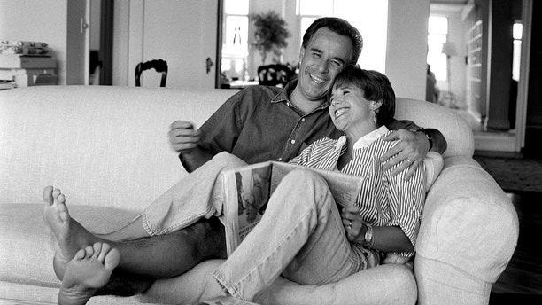 "NBC's the ""Today"" show co-host Katie Couric at home with her husband, MSNBC legal analyst Jay Monahan. (Photo by Deborah Feingold/Corbis via Getty Images)"