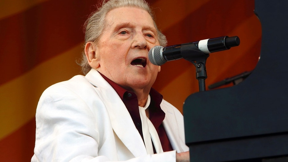 In this May 2, 2015 file photo, Jerry Lee Lewis performs at the New Orleans Jazz & Heritage Festival in New Orleans. Lewis is one of the early pioneers of rock 'n' roll music, but he doesn't understand why his contributions to country music haven't been recognized by the Country Music Hall of Fame.