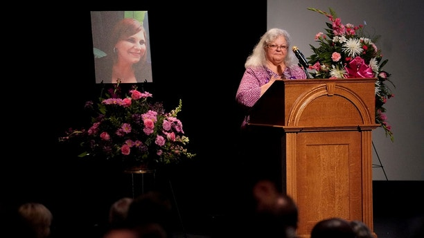 Car attack victim Heather Heyer's mother Susan Bro receives a standing ovation during her remarks at a memorial service for her daughter at the Paramount Theater in Charlottesville, Virginia, U.S. August 16, 2017.  REUTERS/Jonathan Ernst     TPX IMAGES OF THE DAY - RTS1C3TI