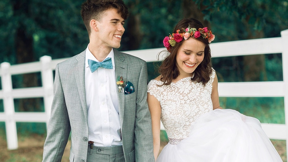 John Luke and Mary Kate Robertson on their wedding day in 2015.