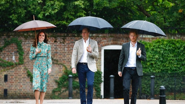 Britain's Prince William, center, his wife Kate, Duchess of Cambridge and Prince Harry arrive for an event at the memorial garden in Kensington Palace, London, Wednesday, Aug. 30, 2017. Princes William and Harry are paying tribute to their mother, Princess Diana, on the eve of the 20th anniversary of her death by visiting the Sunken Garden to honor Diana's work with charities. (AP Photo/Kirsty Wigglesworth)