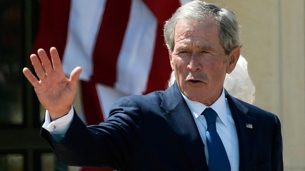 DALLAS, TX - APRIL 25:  Former President George W. Bush waves goodbye after attending the opening ceremony of the George W. Bush Presidential Center April 25, 2013 in Dallas, Texas. The Bush library, which is located on the campus of Southern Methodist University, with more than 70 million pages of paper records, 43,000 artifacts, 200 million emails and four million digital photographs, will be opened to the public on May 1, 2013. The library is the 13th presidential library in the National Archives and Records Administration system.  (Photo by Kevork Djansezian/Getty Images)