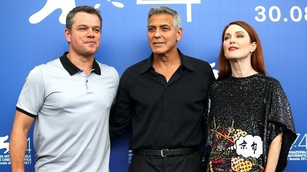 Director George Clooney and actors Matt Damon and Julianne Moore pose during a photocall for the movie