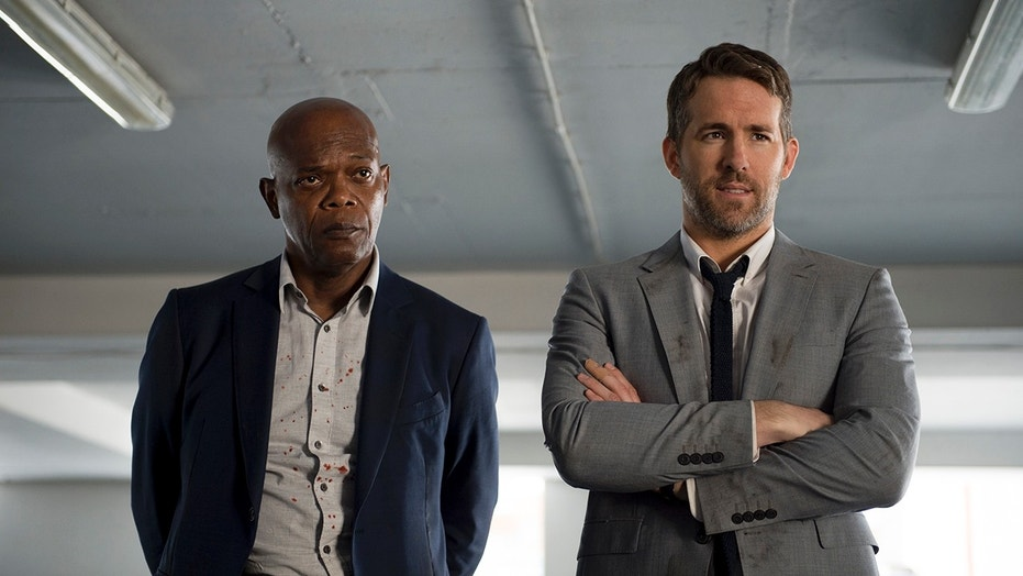 "Samuel L. Jackson and Ryan Reynolds in ""The Hitman's Bodyguard."""