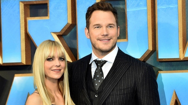 "Chris Pratt (R) poses with his wife Anna Faris as they attend a premiere of the film ""Guardians of the galaxy, Vol. 2"" in London April 24, 2017. REUTERS/Hannah McKay - RC13C45A0AF0"