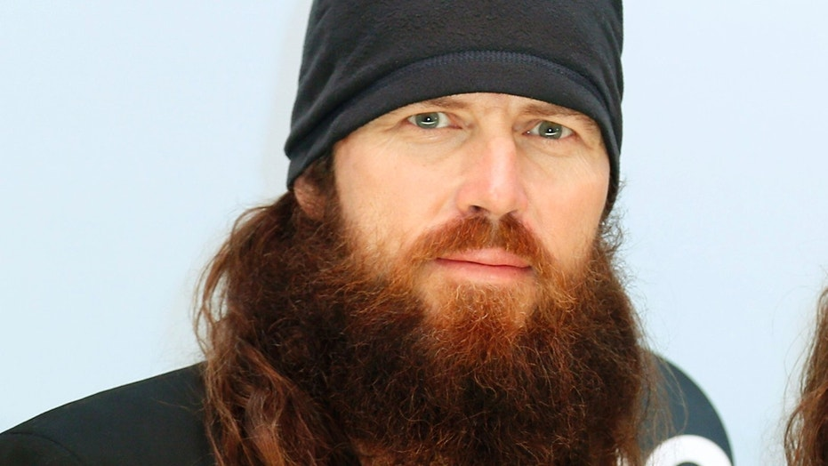 "Jase Robertson from ""Duck Dynasty"" poses on arrival at the 47th Country Music Association Awards in Nashville, Tennessee November 6, 2013."