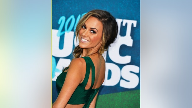 Actress Jana Kramer arrives at the 2015 CMT Awards in Nashville, Tennessee June 10, 2015. REUTERS/Eric Henderson - RTX1G08K