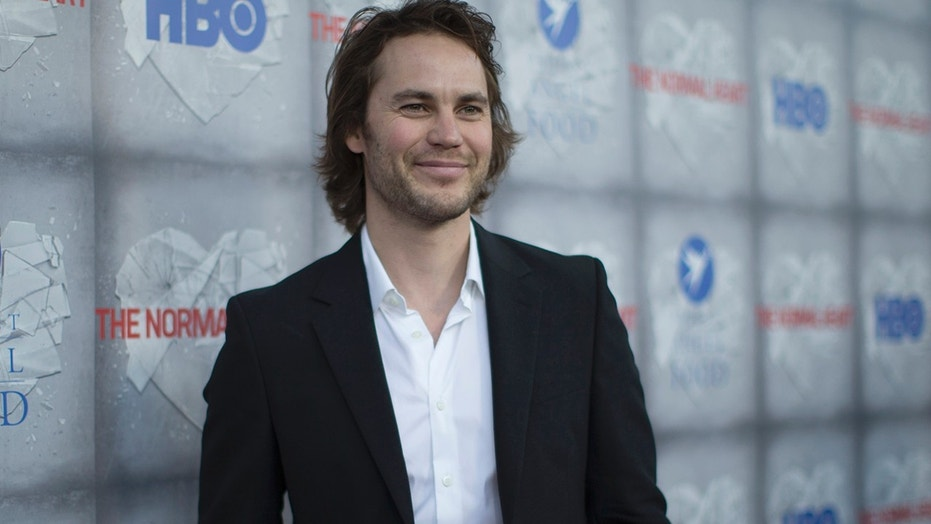 "Taylor Kitsch poses at the premiere of HBO's ""The Normal Heart"" on May 19, 2014."