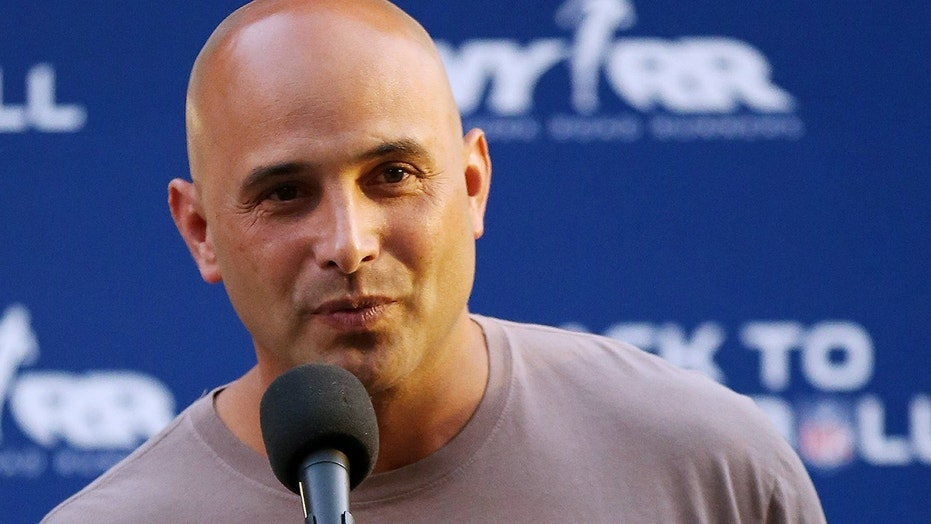"In this Aug. 30, 2012, file photo, Craig Carton talks during the National Football League Back to Football Run at Central Park in New York. Federal officials said the New York sports radio host is in custody and details of the charges against the host of WFAN-AM's ""Boomer and Carton"" show were not immediately made public Wednesday, Sept. 6, 2017."