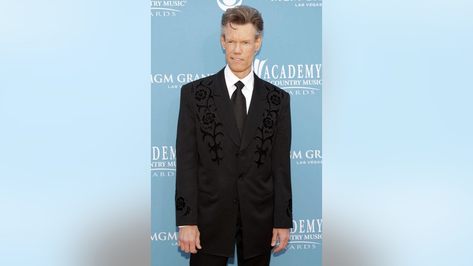 Singer Randy Travis is making another attempt to block the video of his 2012 arrest.