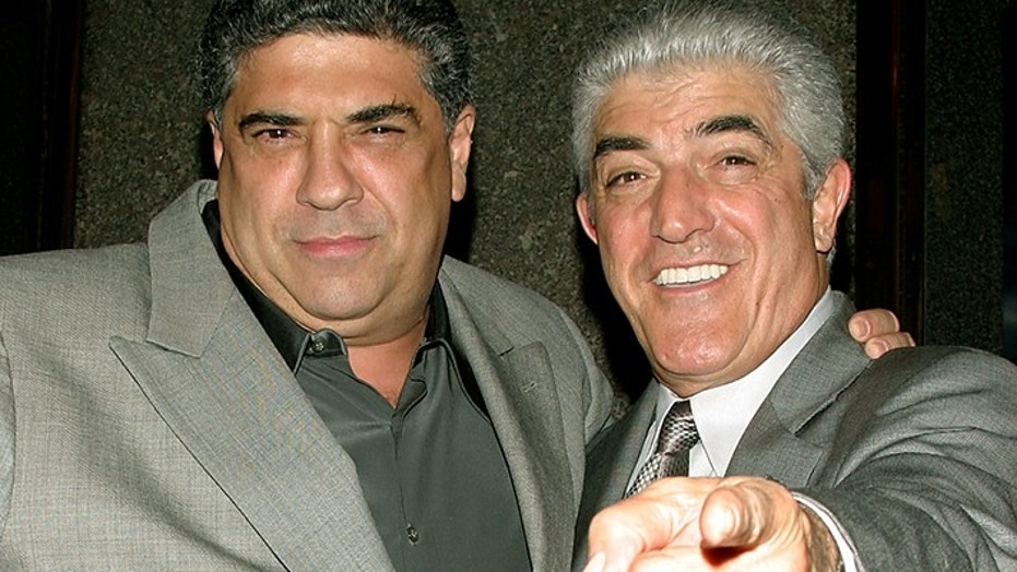 "Actors Vincent Pastore (L) and Frank Vincent point at the photographers as they arrive for the fifth season premiere of the HBO series ""The Sopranos,"" in New York March 2, 2004. - PBEAHUOKKBB"