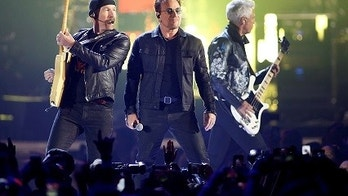 Bono (C), guitarist The Edge (L) and bass guitarist Adam Clayton of U2 perform during the iHeartRadio Music Festival at The T-Mobile Arena in Las Vegas, Nevada, U.S. September 23, 2016. REUTERS/Steve Marcus - S1AEUDCFQZAA