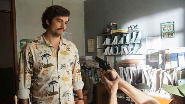 "This undated production photo provided by Netflix, shows actor Wagner Moura as Pablo Escobar, in the Netflix Original Series ""Narcos.""  Moura studied Spanish in Medellin, Colombia, to approach the capo's thick regional accent. (Daniel Daza/Netflix via AP)"