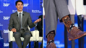 "In this combination photo, Canadian Prime Minister Justin Trudeau wears socks featuring the ""Star Wars"" character Chewbacca during a panel discussion at the Bloomberg Global Business Forum, Wednesday, Sept. 20, 2017, in New York. (AP Photo/Mark Lennihan, left, and Adrian Wyld/The Canadian Press via AP)"