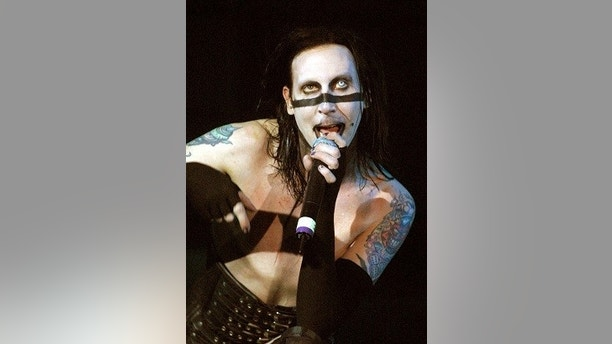 "Marilyn Manson performs during a sold-out show July 1, 2001 at the House of Blues inside the Mandalay Bay Resort & Casino in Las Vegas. Manson is touring in support of his album ""Holy Wood: In the Valley of the Shadow of Death."" - PBEAHUKZUEQ"