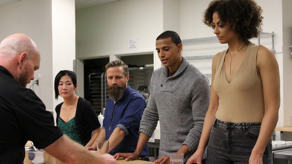 Alicia Jay and her date Adonis take a couples cooking class at Raise the Root in Oakland, California.
