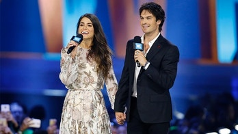 Actors Nikki Reed and Ian Somerhalder speak on stage during We Day California in Inglewood, California, April 7, 2016. REUTERS/Danny Moloshok - D1AESXAUKVAA