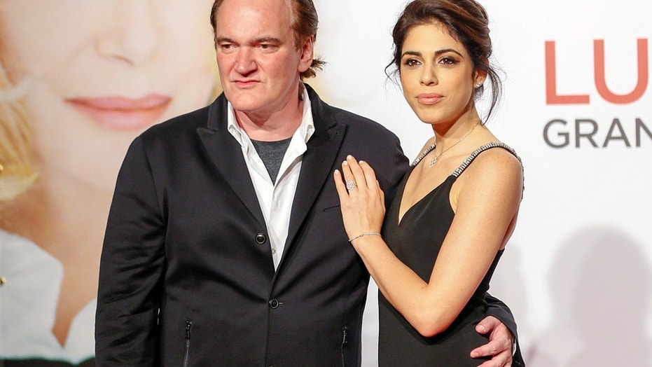 Director Quentin Tarantino (L) and model and singer Daniella Pick arrive at the opening day of the Lumiere Festival in Lyon, France, October 8, 2016.