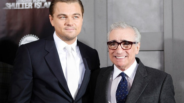 "Director Martin Scorsese (R) poses with cast member Leonardo DiCaprio as they arrive at the premiere of the movie ""Shutter Island"" in New York February 17, 2010."