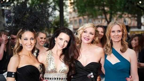 (From L-R) Actresses Sarah Jessica Parker, Kristin Davis, Kim Catrall and Cynthia Nixon pose for photographers at the premiere of their new film